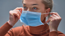 Female Putting On Medical Protective Mask To Health Protection And Prevention During Flu Virus Outbreak, Epidemic And Infectious Diseases