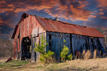 An Old Barn With A Rusty Roof ...