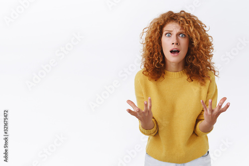Shocked redhead curly girl in despair, panicking, shaking arms and stare camera Canvas-taulu