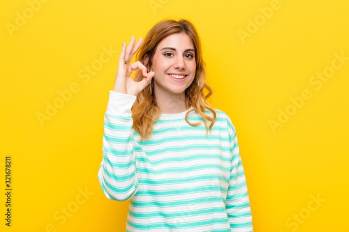 Photo young pretty blonde woman feeling happy, relaxed and satisfied, showing approval