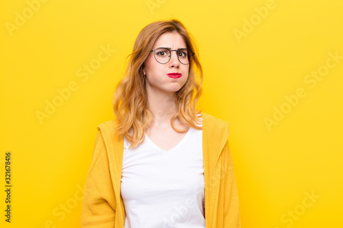 young pretty blonde woman with a goofy, crazy, surprised expression, puffing che Wallpaper Mural