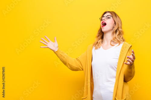 young pretty blonde woman performing opera or singing at a concert or show, feel Wallpaper Mural