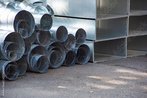 A pile of shiny round and rectangular ventilation ducts Canvas Print