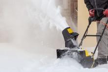 Man Is Brushing White Snow Wit...