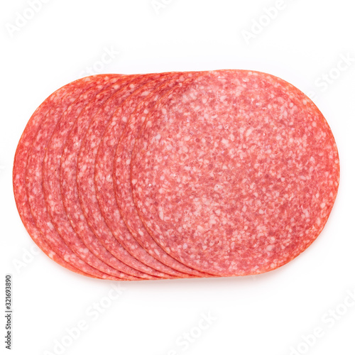 Salami slices on white background. Canvas-taulu