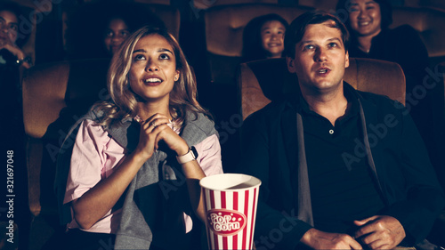 Photo Audience applauding and enjoy at the end of movie and walked out of the cinema