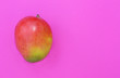 Leinwanddruck Bild - Tropical fruit mango on pink background.