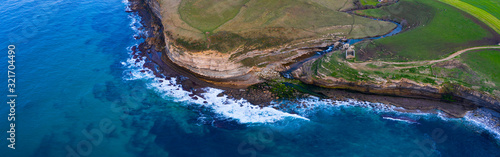 Cliffs and Mill of El Bolao, Cóbreces, Alfoz de Loredo Municipality, Cantabrian Sea, Cantabria, Spain, Europe