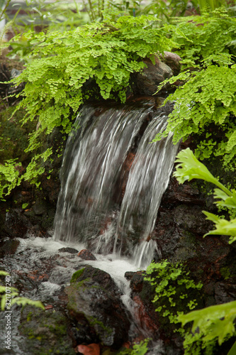 Waterfall outdoors with greenery