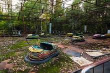 Amusement Cars Attraction In Park In Pripyat. Exclusion Zone Of Chernobyl Ghost City