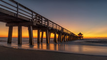 Naples Pier On The Beach At Sunset In Naples, Florida, USA. Famous And Beautiful Old Architecture. Coastal Dreams. Lighthouse On Pier.