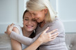 Leinwanddruck Bild Happy mature mom hug grownup daughter relaxing at home together