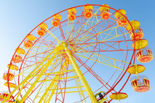 Ferris Wheel On A Background O...
