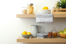 Wooden Shelves With Dishware A...