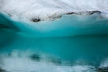 Iceberg Reflecting In Teal Water