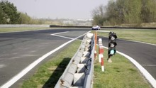 Fast Car Passing With Full Speed And Breaking With ABS On Race Track