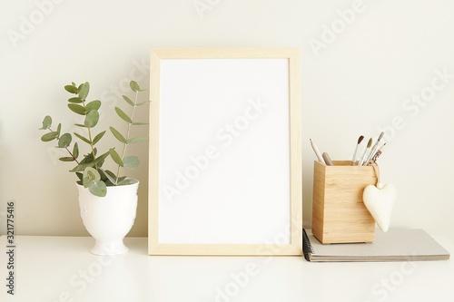 Obraz Minimalist interior empty frame mock up on white background, eucalyptus and wooden decoration.        - fototapety do salonu