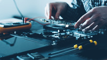 Electronics Repair Shop. Hardware Maintenance. Male Engineer Working With Laptop Components.