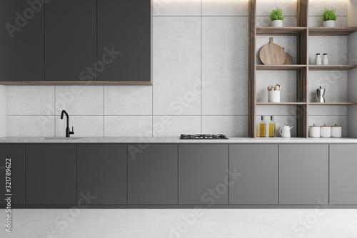 Fototapeta White kitchen with gray countertops and shelves obraz