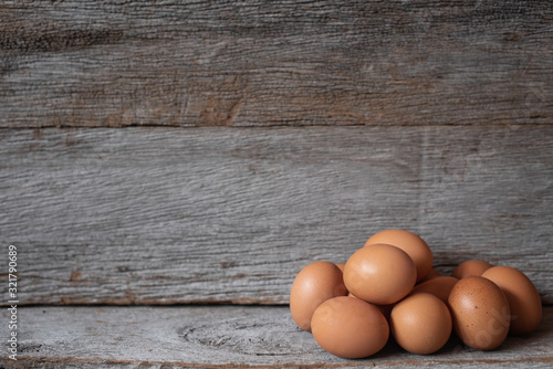 Chicken eggs on the old wood with a wooden wall in the background Canvas Print