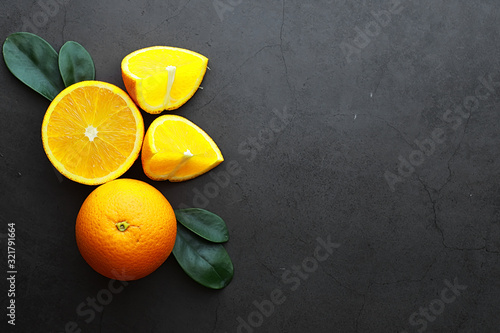 Foto Orange citrus fruit on a stone table. Orange background.