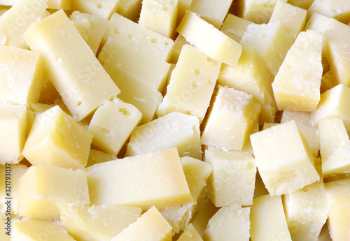 Background of pieces of fresh cheese all cut into cubes Canvas Print