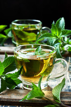 Close-up Cup Of Mint Tea With Herbs