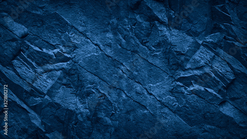 Obraz Blue stone background. Toned rock texture. Close-up. Dark blue grunge background with copy space for your design. - fototapety do salonu