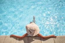 Young Woman Relaxing In The Swimming Pool With Copy Space