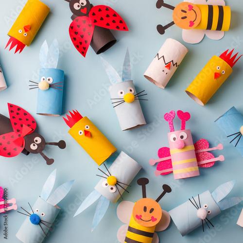 Happy easter kindergarten decoration concept - rabbit, chicken, egg, bee from toilet paper roll tube Fotobehang