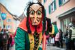 canvas print picture - Freiburger Hexen - Hexe mit Katzenaugen im  grün, gelb, rotem Gewand mit schwarzen Zöpfen und krummer Nase. Bei Fastnachtsumzug in Staufen Süd Deutschland.