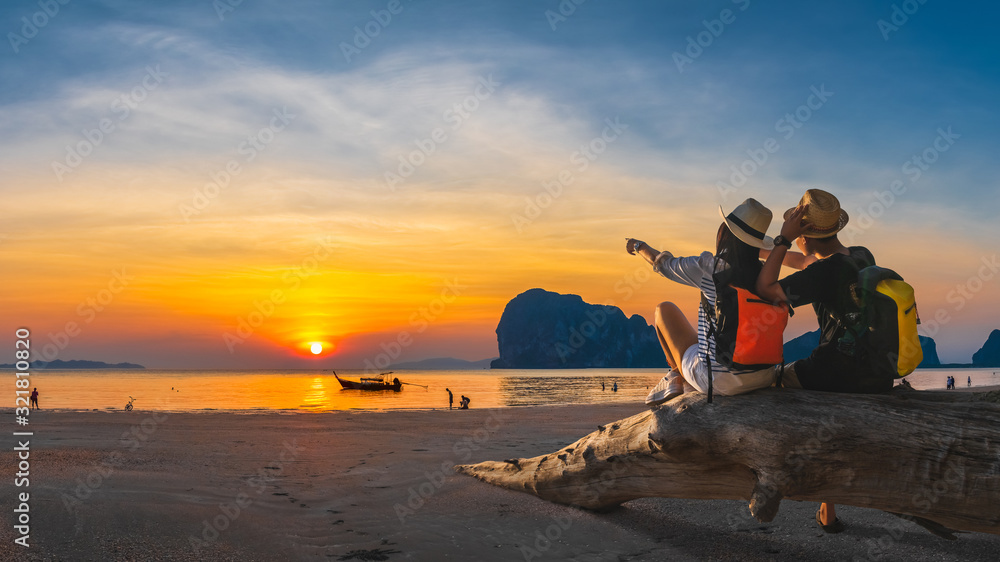 Fototapeta Romantic couple traveler joy look beautiful nature at sunset Pak Meng beach Outdoor lifestyle attraction travel Trang Thailand exotic beach Tourist on summer holiday vacation, Tourism destination Asia