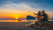 canvas print picture Romantic couple traveler joy look beautiful nature at sunset Pak Meng beach Outdoor lifestyle attraction travel Trang Thailand exotic beach Tourist on summer holiday vacation, Tourism destination Asia