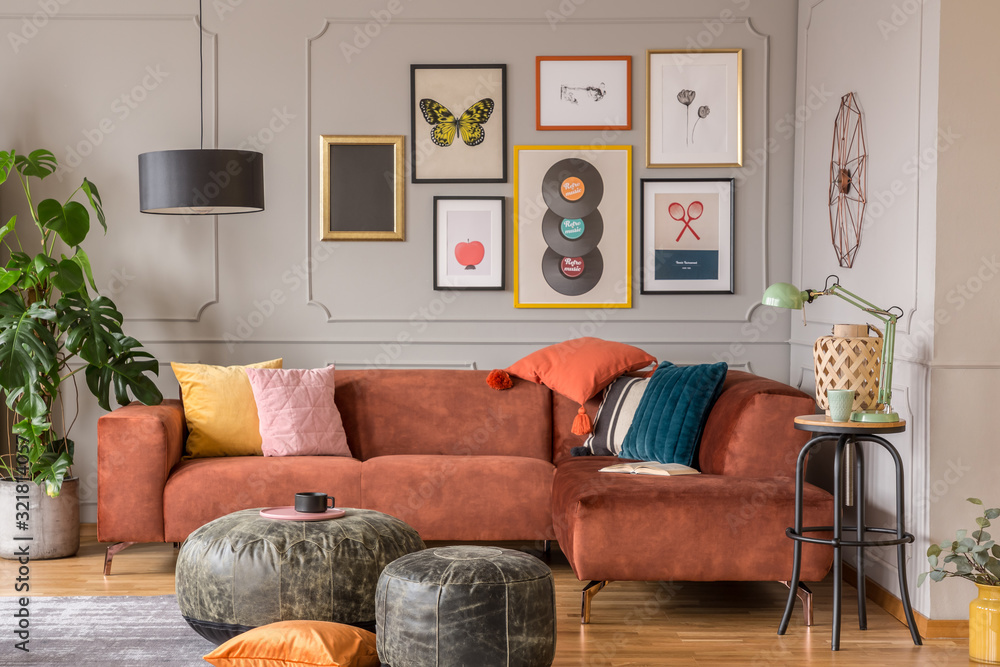 Fototapeta Vintage black poufs in trendy eclectic living room interior with brown couch