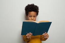 Serious Black Kid Boy Reading ...
