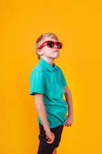 Young Cute Boy In Red Sunglass...