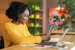 Black woman graphic designer working with color palette at cafe