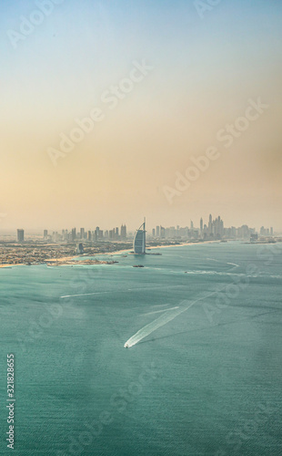 Fotomural Aerial view of Dubai coast and Marina Skyline at sunset