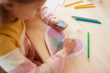 High Angle View At Cute Little Girl Making Handmade Card For Mothers Day, Copy Space
