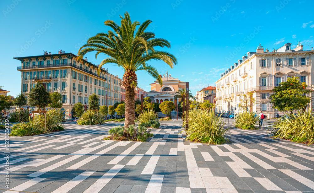 Architecture church of Eglise Saint Jean-Baptiste with Esplanade de la Bourgada park - Nice, France