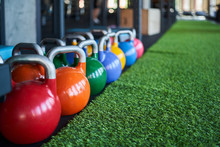 Colorful Kettle Bells In Row O...