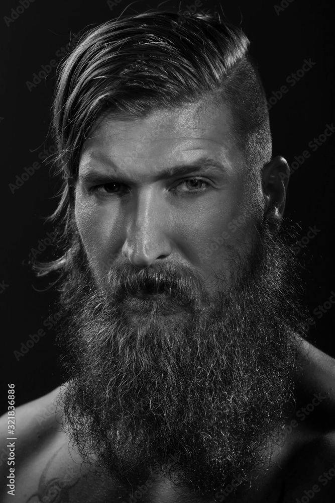 Fototapeta Black and white portrait of a young bearded man