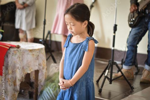 Religious christian girl praying in church Canvas Print
