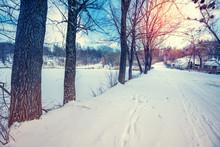 Winter Snowy Country Road Along A Frozen Lake