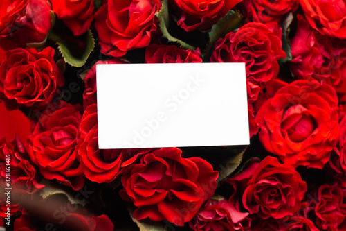card in bouquet of red roses. secret admirer. Valentines day Wallpaper Mural