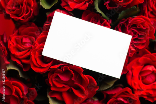 card in bouquet of red roses. secret admirer. Valentines day Canvas Print