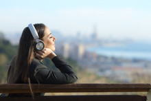 Businesswoman Relaxing Listening To Music Outdoors
