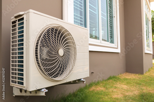 Air conditioner compressor outdoor unit installed outside the house Canvas Print