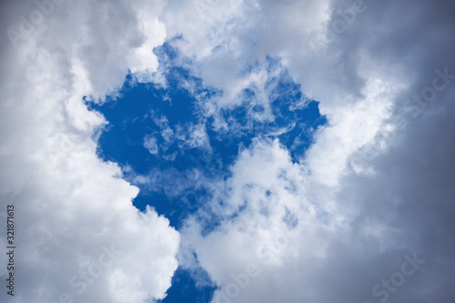 Photo Clouds on dark blue sky