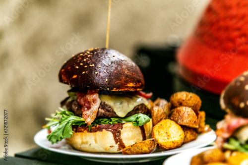 Sandwich hamburger with and mix of vegetables. Fast food. Delicious hamburger © Ivan